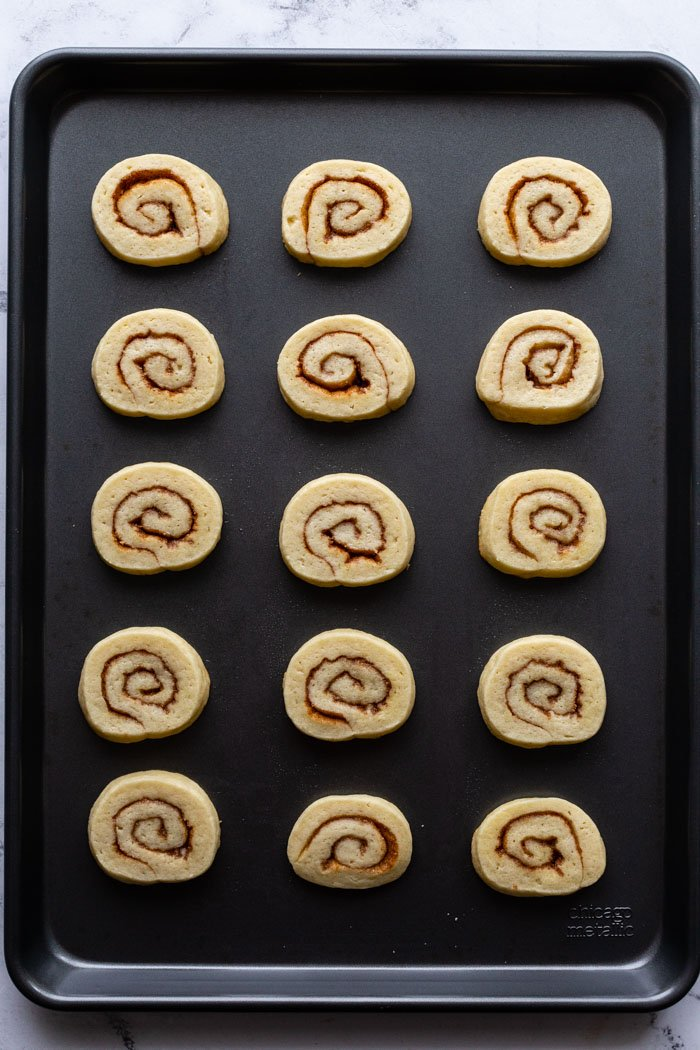 sheet pan filled with cinnamon roll cookies