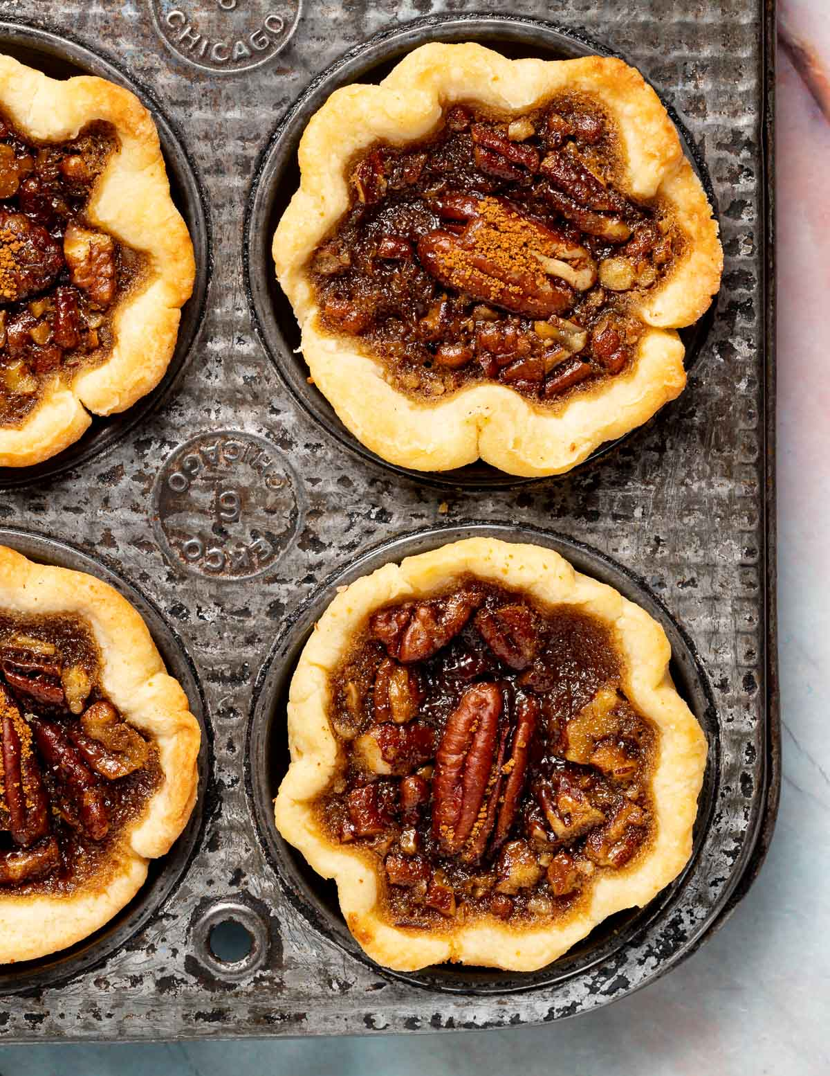 mini butter tarts in a muffin tin