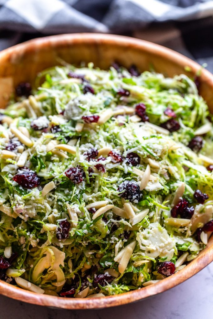 Brussel Sprout Salad topped with cranberries and almonds