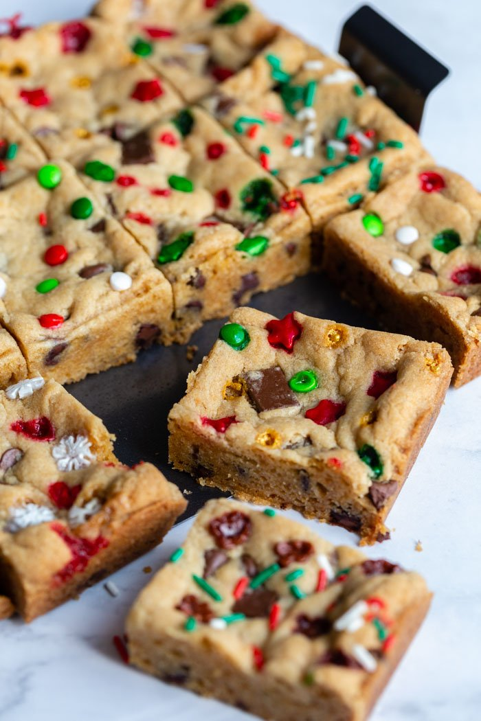 chocolate chip cookie bars with red and green and white sprinkles. cut in squares