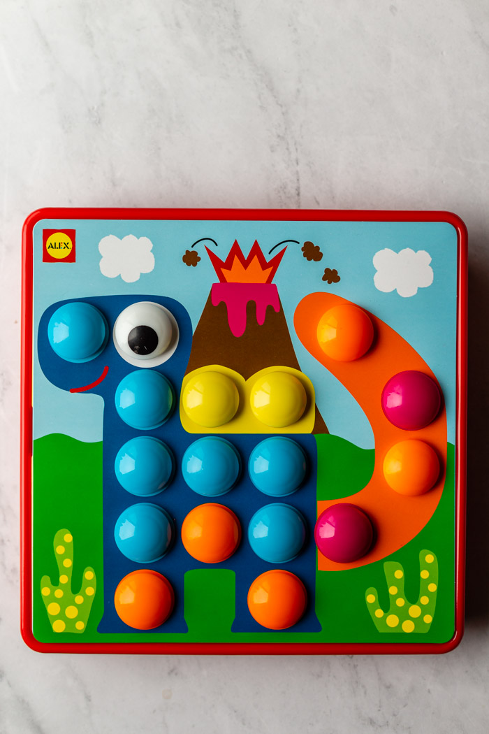 kids dot toy with a dinosaur print