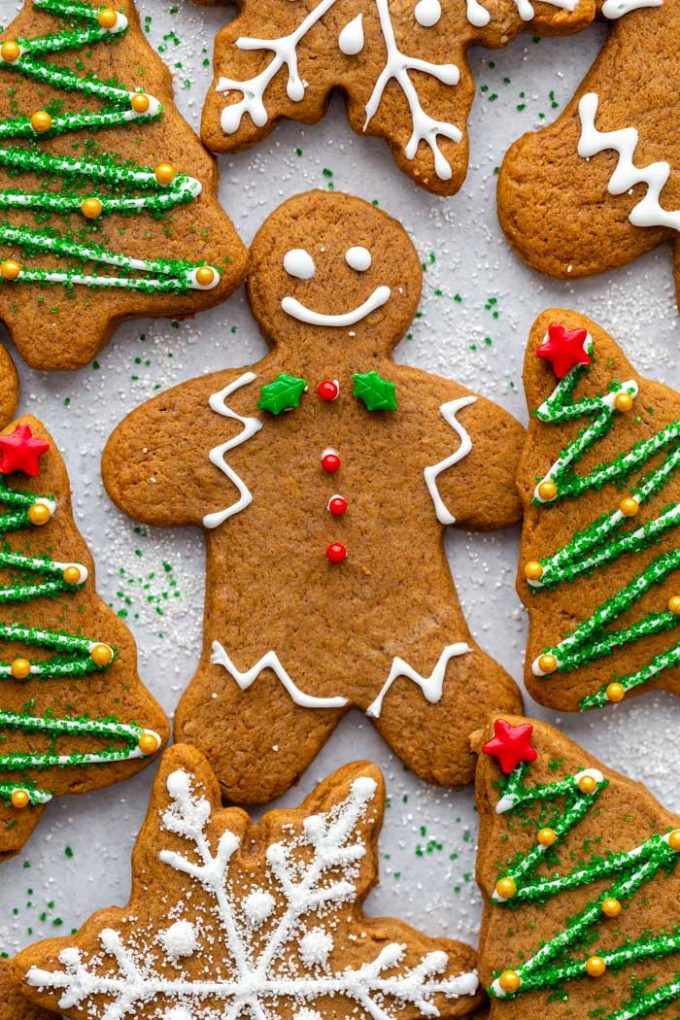 gingerbread cookies cut into shapes and decorated with icing
