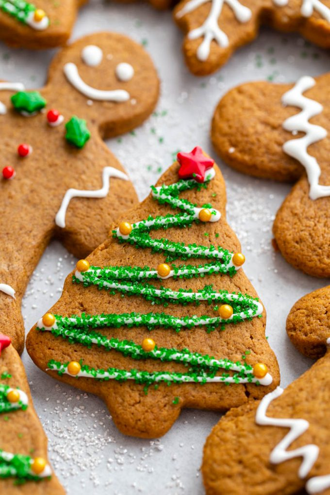gingerbread cookie decorated like a Christmas tree