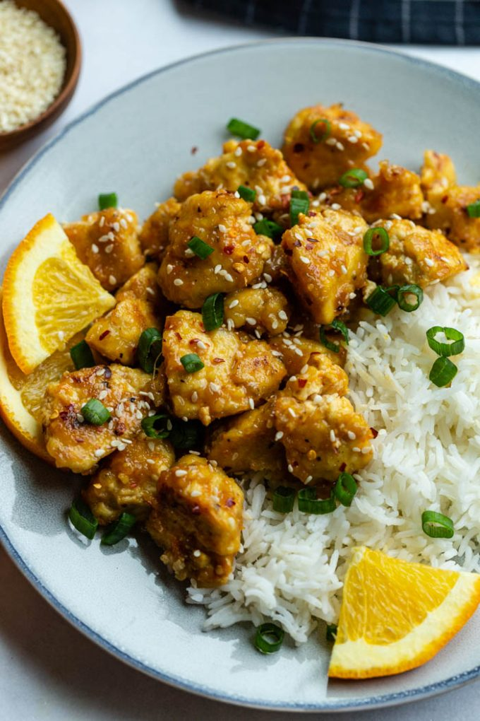 tofu marinated in orange sauce and served with orange wedges