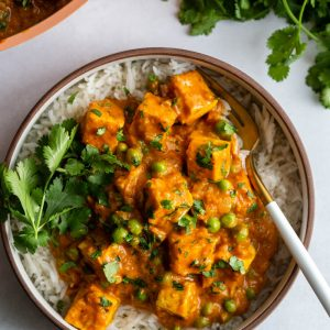 tofu tikka masala served over rice and garnished with cilantro