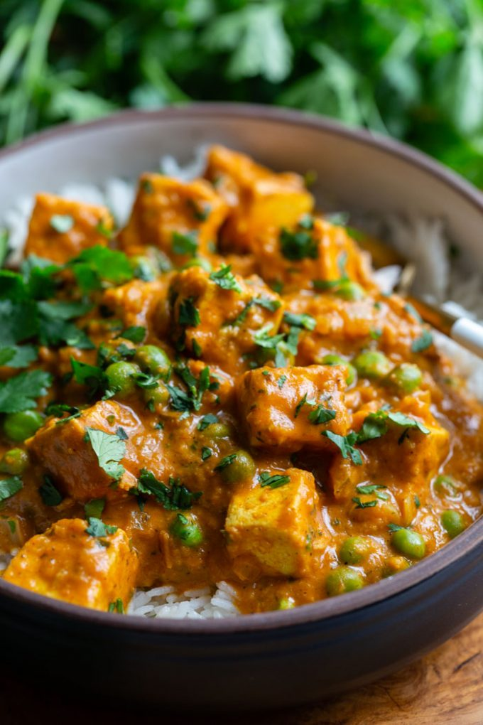 tofu tikka masala served over rice and topped with fresh cilantro
