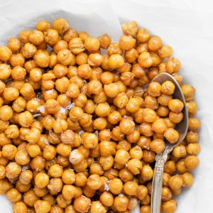 crispy chickpeas on a white plate with a spoon on the side
