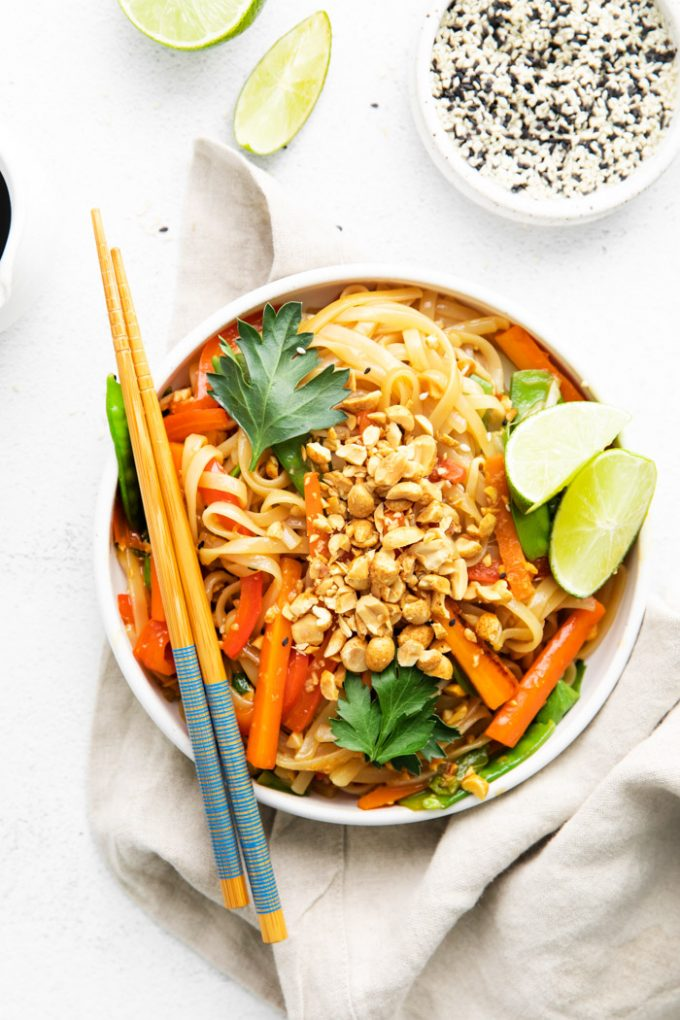 vegan Pad Thai served in a white bowl with chopsticks