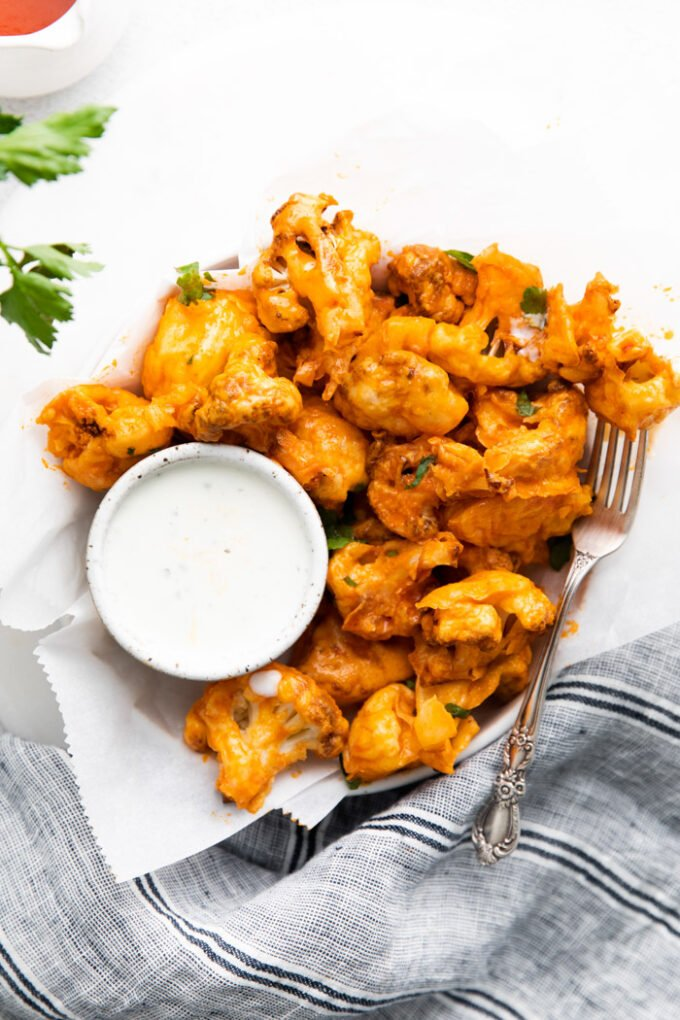 air fryer buffalo cauliflower served with a white dipping sauce