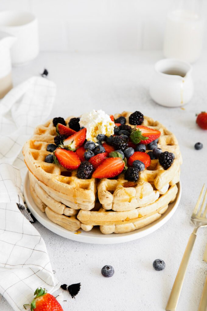 easy vegan waffles served with berries and whipped cream
