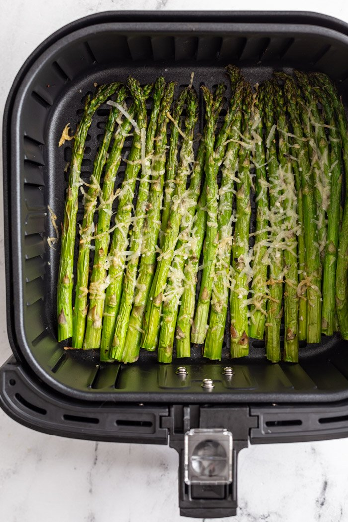 asparagus air fryer cooked and toped with cheese