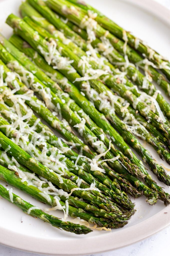 air fryer asparagus topped with parmesan cheese