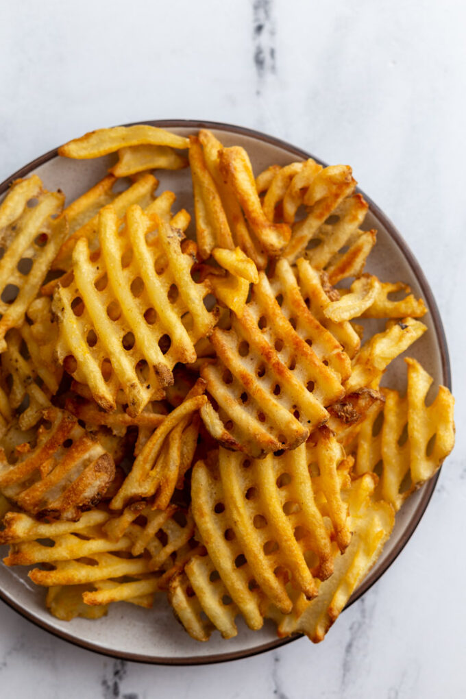 plate full of waffle fries