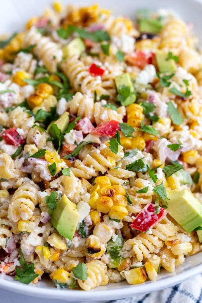 up close shot of street corn pasta salad made with rotini and lots of fresh veggies