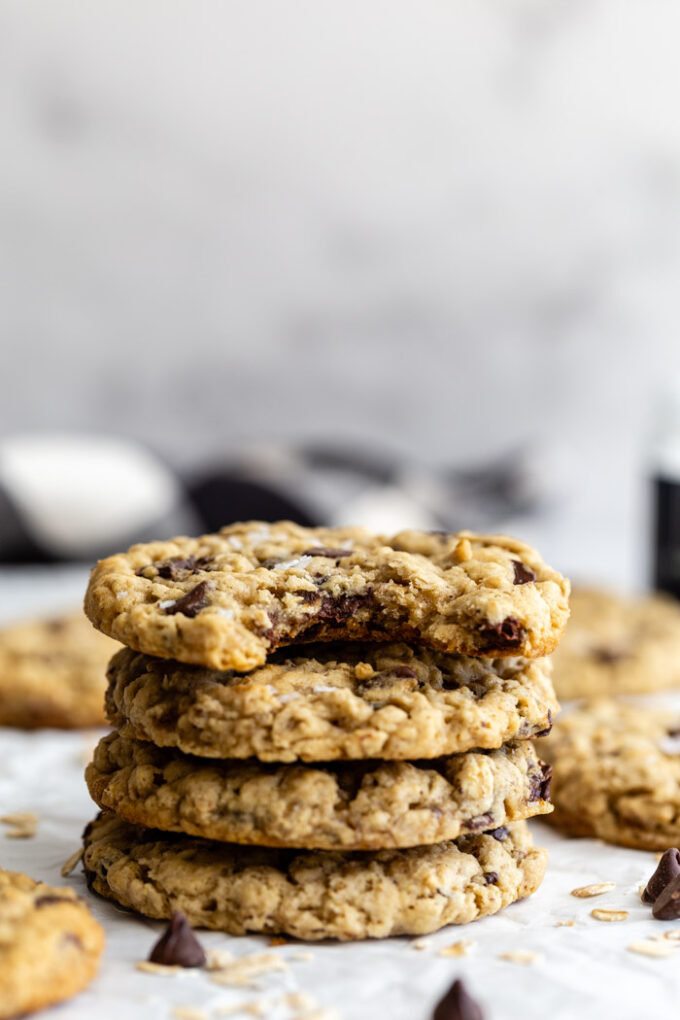 stack of oatmeal chocolate chip cookies with more in the background