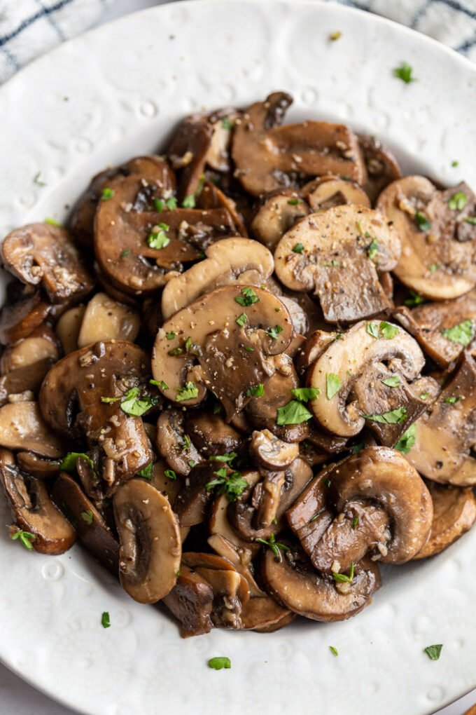sautéed mushrooms served in a white bowl