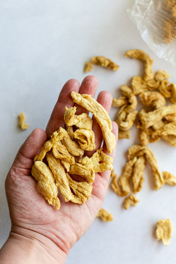 hand holding up soy curls