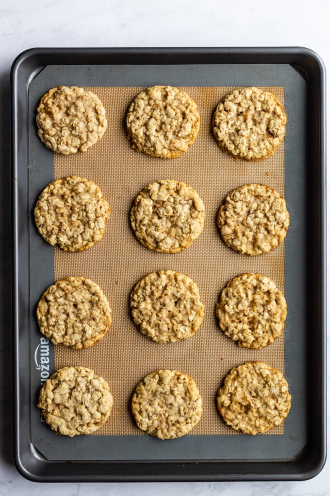 large cookie sheet with oatmeal cookies sitting on top