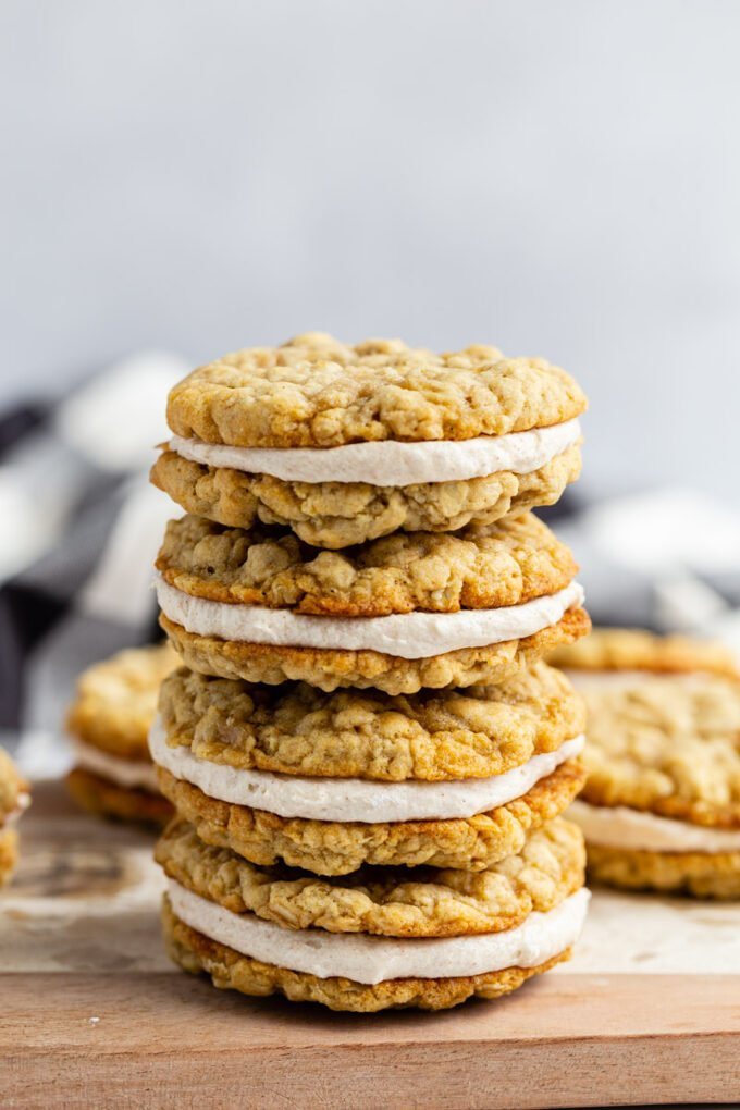 oatmeal cream pies stacked on top of each other on a wood and marble board