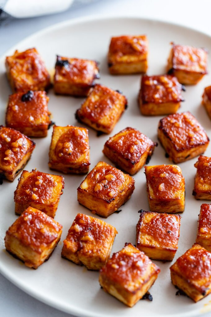plate of bbq tofu cubes covered in sauce