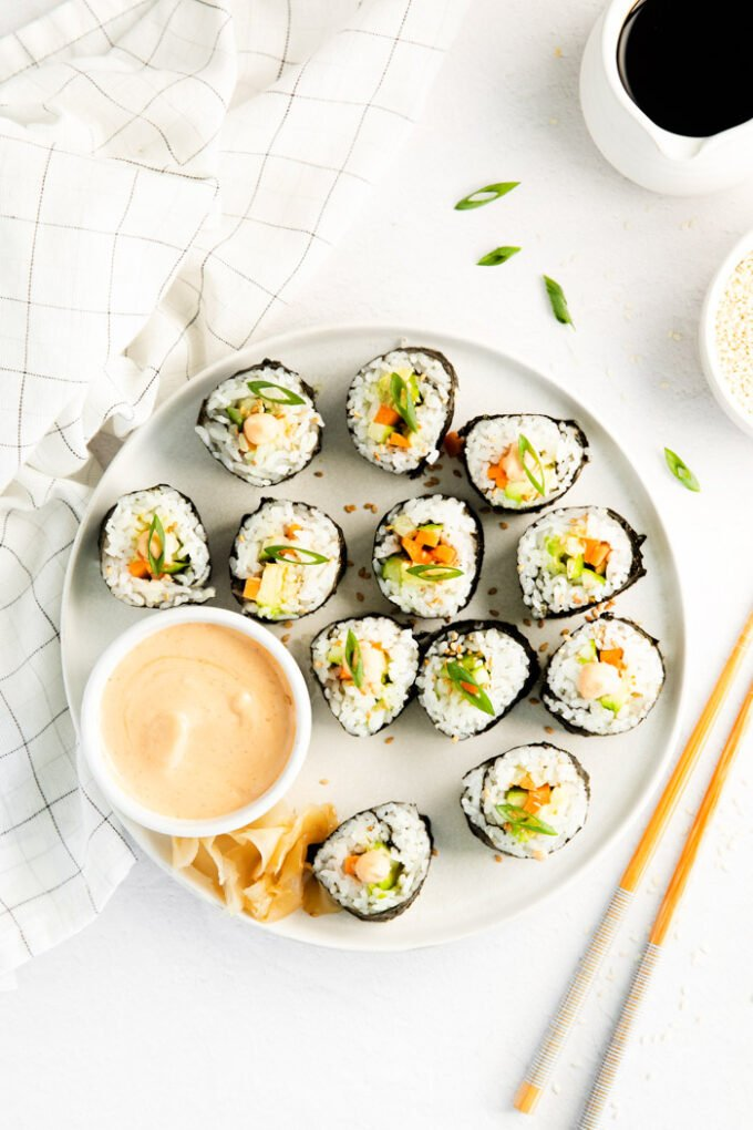 cucumber rolls on a large plate with dipping sauce