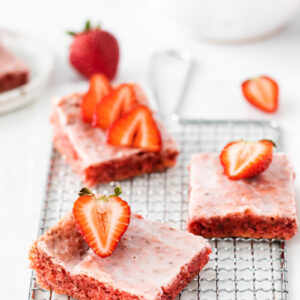 strawberry blondies on a wire cooling rack