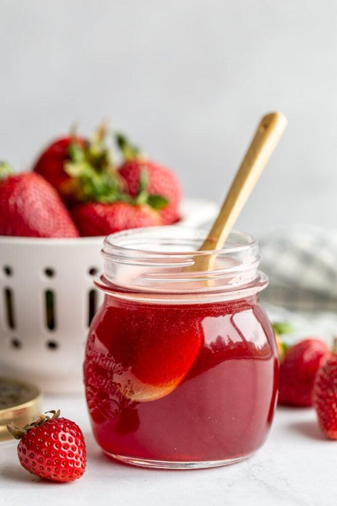 strawberry juice in a small glass mason jar