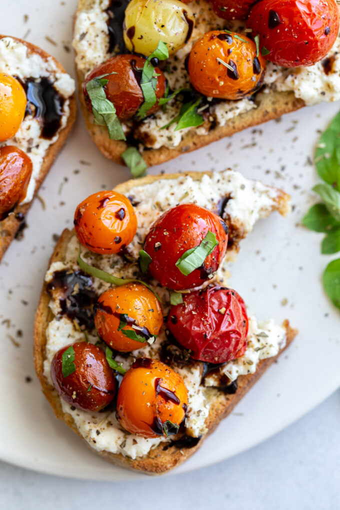 blistered tomatoes served over toast with balsamic glaze