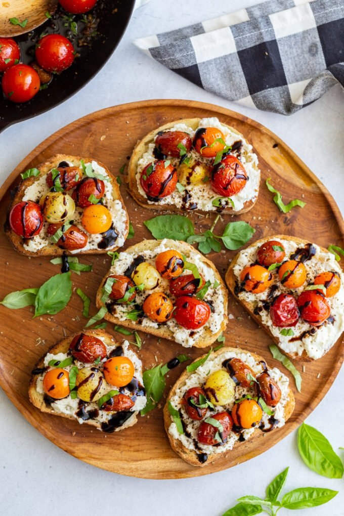 toast topped with ricotta, blistered tomatoes and basil