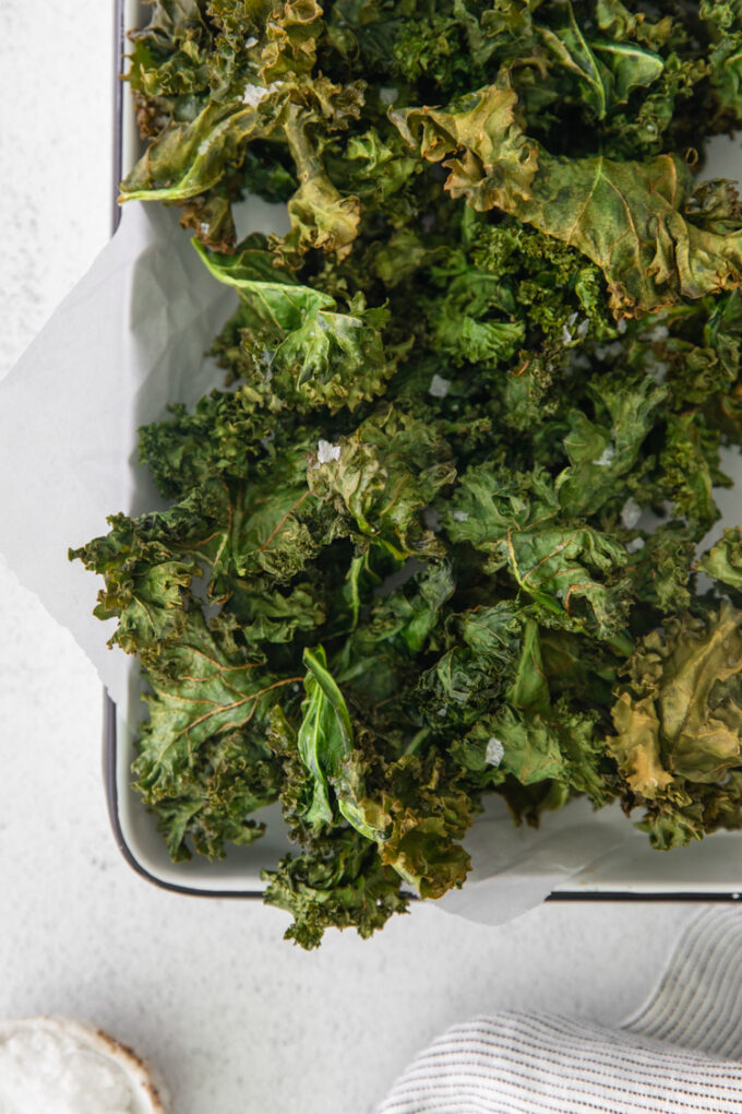 air fryer kale chips in a large serving tray