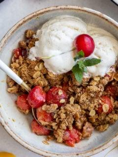 cherry crisp served with vanilla ice cream