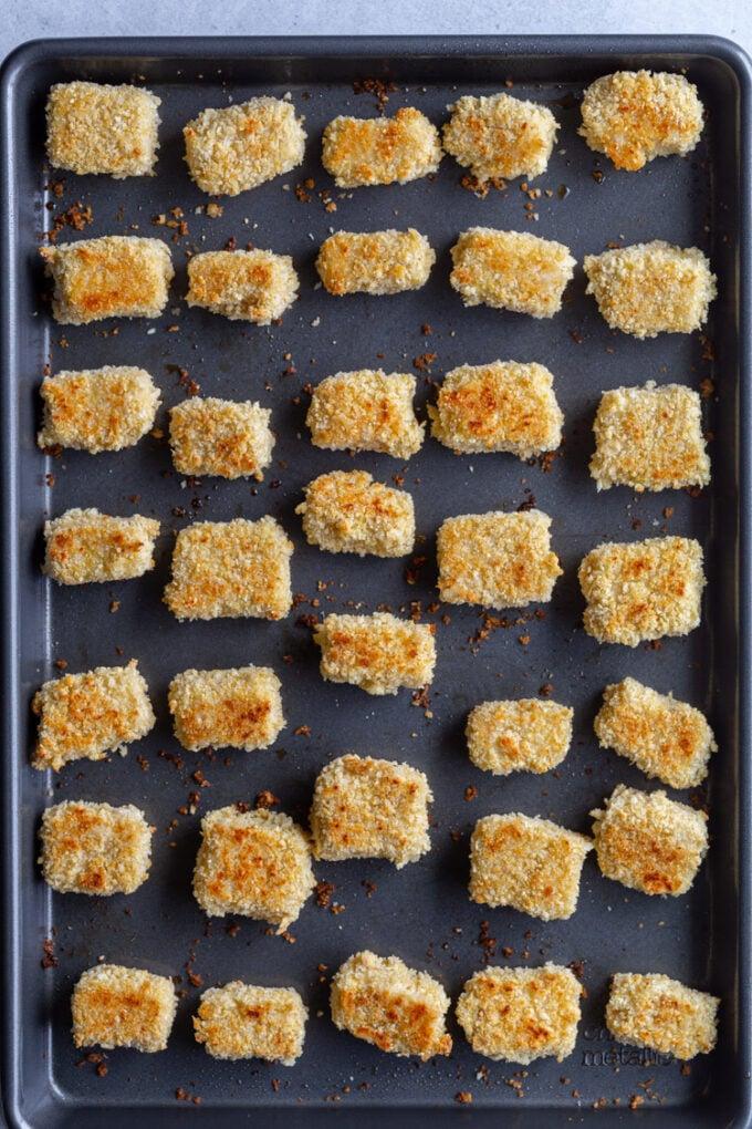 crispy tofu lined up on a baking sheet
