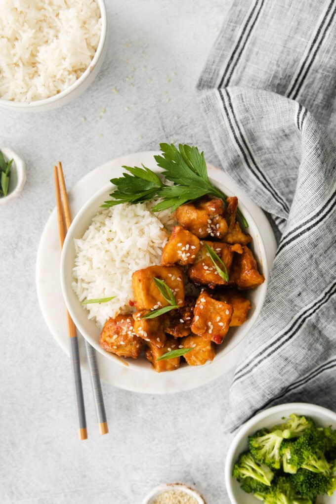 spicy tofu served with chopsticks in a small white bowl with white rice