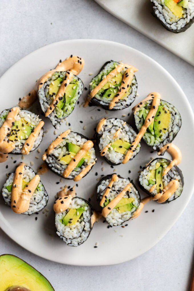 avocado sushi rolls topped with spicy mayo