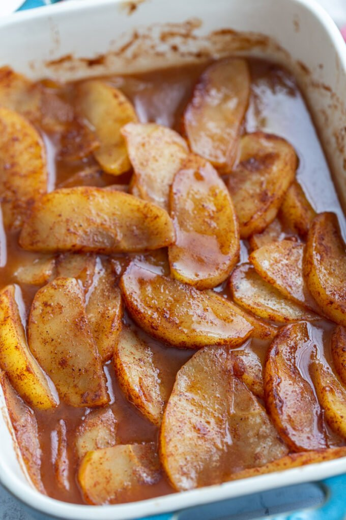 baked cinnamon apples in a baking dish