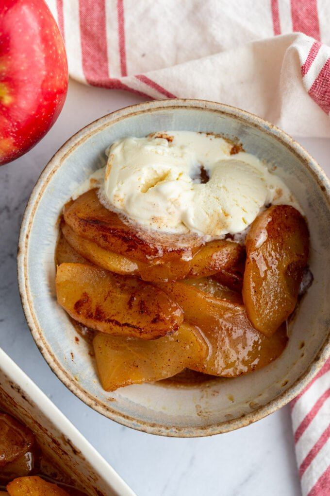 Baked Cinnamon Apples topped with vanilla ice cream