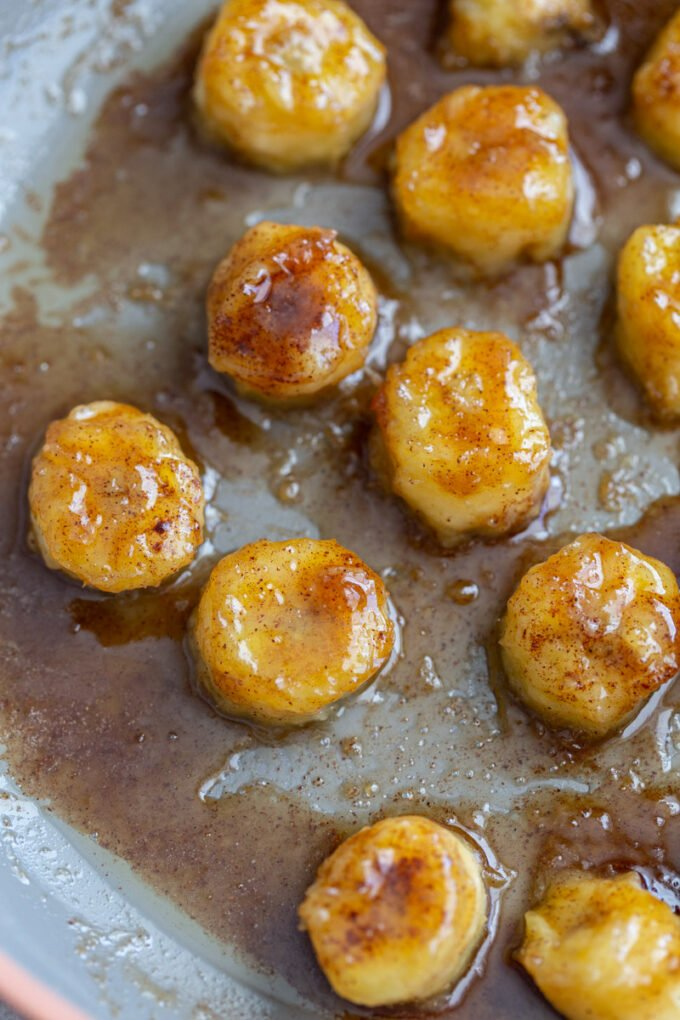 caramelized bananas cooking on a skillet