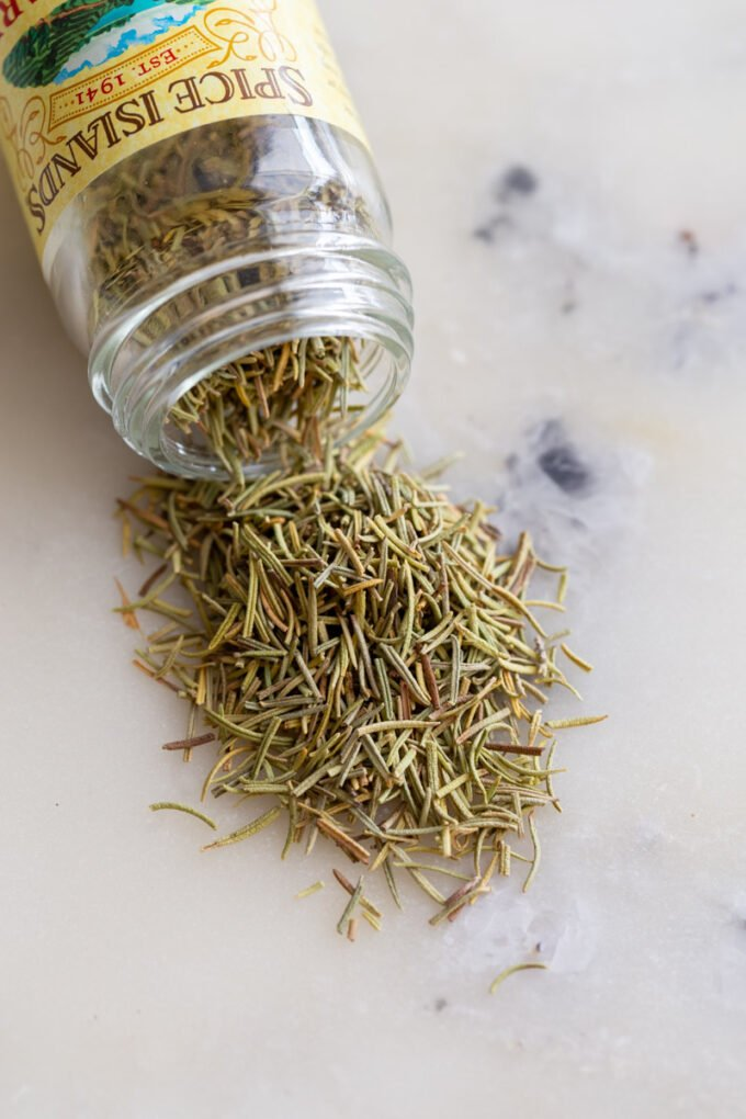 jar of spilled dried rosemary