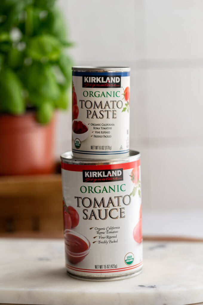 jar of tomato paste on top of a jar of tomato sauce