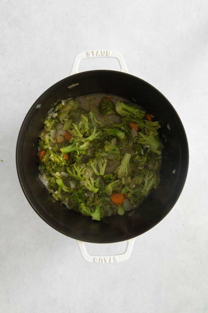 cooking broccoli in broth in a large pot