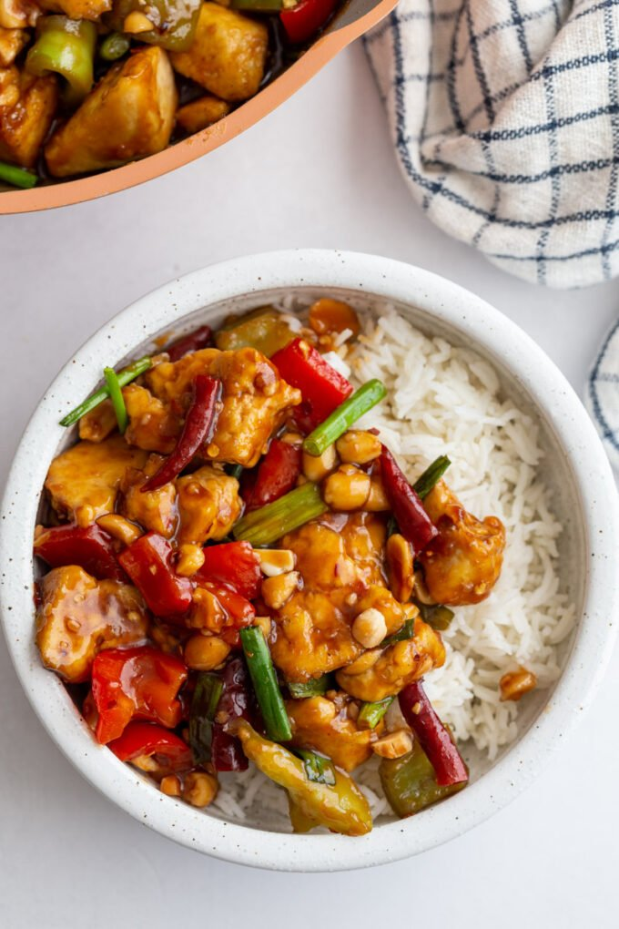 Kung Pao tofu served over white rice in a small white bowl