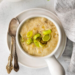 Vegan Potato Leek Soup in a small white soup bowl