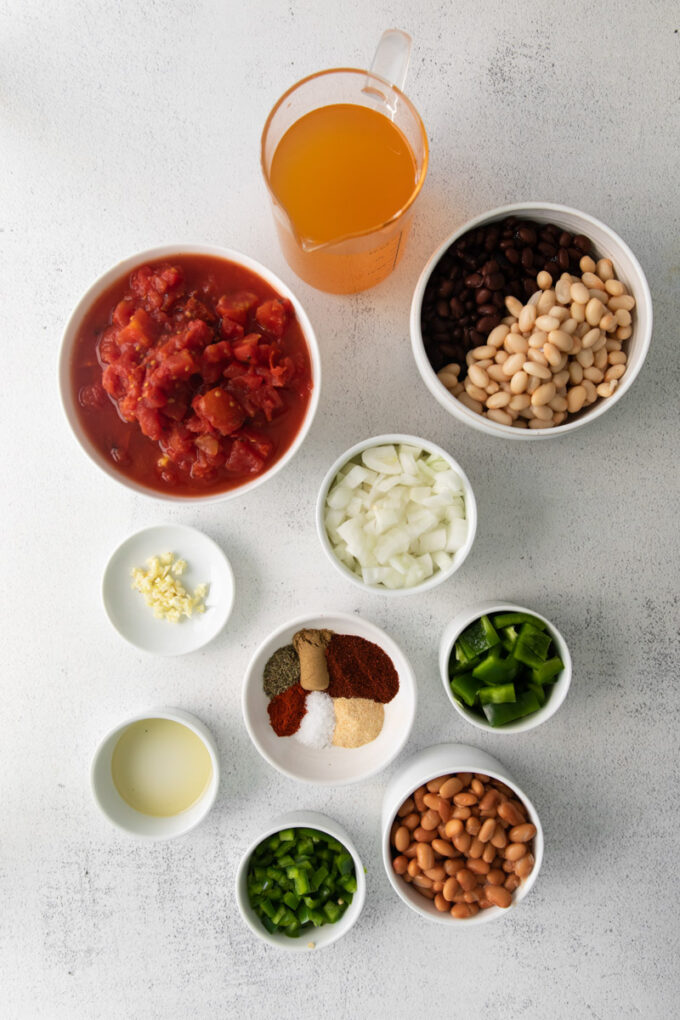 vegetarian taco soup ingredients divided into small bowls