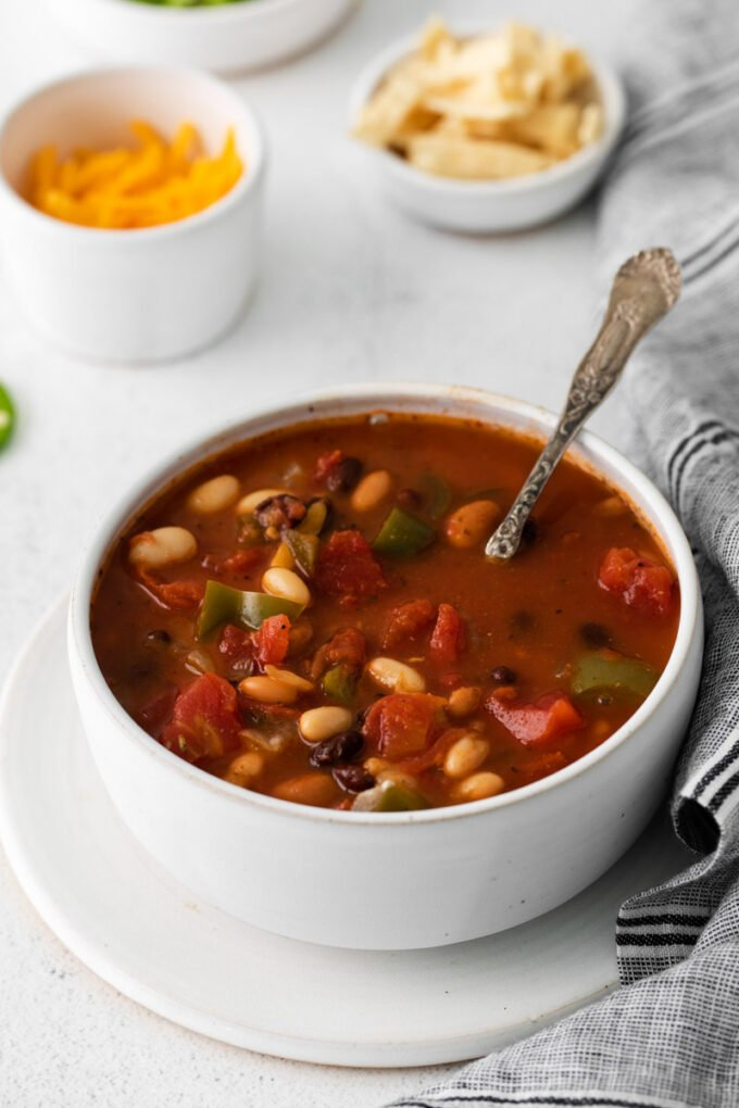 bowl of vegetarian taco soup with a spoon in it